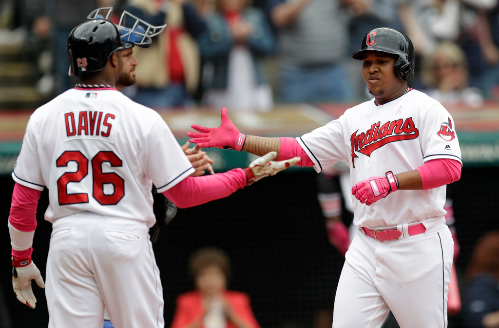 . Cleveland Indians\' Jose Ramirez, right, is congratulated by Rajai Davis after Ramirez hit a three run home run off Kansas City Royals starting pitcher Danny Duffy in the second inning of a baseball game, Sunday, May 13, 2018, in Cleveland. Rajai Davis and Michael Brantley scored on the play. (AP Photo/Tony Dejak)