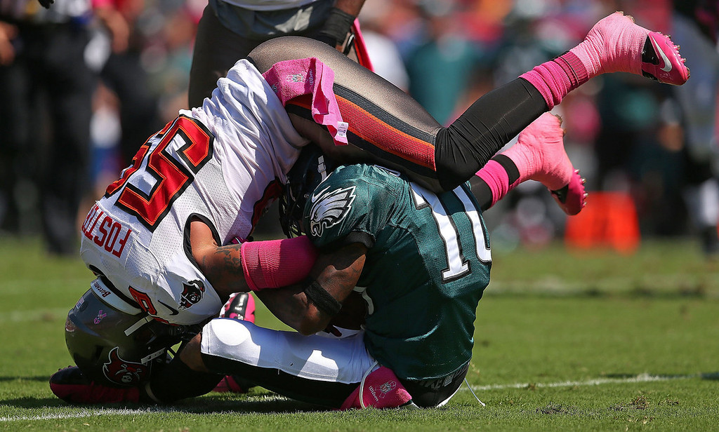 . DeSean Jackson #10 of the Philadelphia Eagles is tackled by Mason Foster #59 of the Tampa Bay Buccaneers during a game  at Raymond James Stadium on October 13, 2013 in Tampa, Florida.  (Photo by Mike Ehrmann/Getty Images)