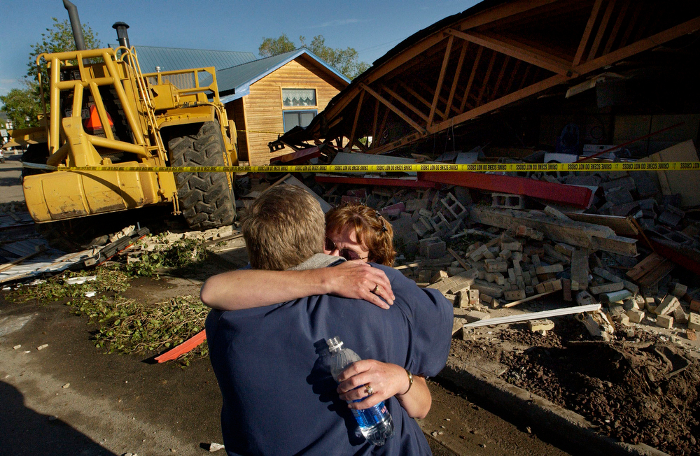 . Casey and Rhonda Farrell owners of Gambles of Grand County survey the damage to their business on Highway 40 in Granby, CO, June 5, 2004. The shop was destroyed when a fortified bulldozer  driven by Marvin Heemeyer plowed into it. Heemeyer drove a fortified bulldozer through the streets of Granby Friday destroying a number of buildings.   (DENVER POST PHOTO BY CRAIG F. WALKER)