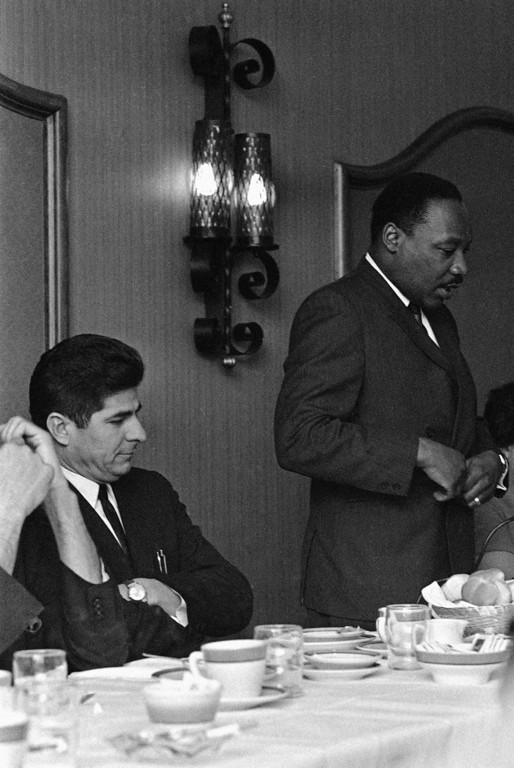 . Dr. Martin Luther King Jr., standing, is applauded during a closed session with representatives of American Indians, Puerto Rican groups, Appalachian Whites and other minorities in Atlanta, Georgia  Thursday, March 14, 1968. Applauding, left, is Reies Lopez Tijerina, leader of a Spanish-American group in Albuquerque, New Mexico and now free on appeal bond on conviction of assault in connection with one of two armed takeovers of property in New Mexico. The meeting was held to discuss plans for King�s mid-June March on Washington. (AP Photo)