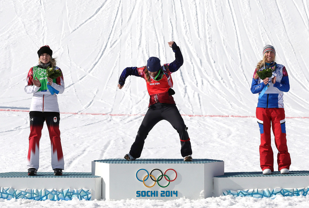 . Czech Republic\'s Eva Samkova, center, celebrates after taking the gold medal in the women\'s snowboard cross final, ahead of silver medalist Dominique Maltais of Canada, left, and bronze medalist France\'s Chloe Trespeuch at the Rosa Khutor Extreme Park, at the 2014 Winter Olympics, Sunday, Feb. 16, 2014, in Krasnaya Polyana, Russia. (AP Photo/Andy Wong)