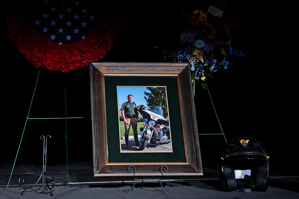 . A photo of Sgt. David Baldwin was put up for people to view during the funeral for the Jefferson County Sheriff Deputy, who died Sunday after being hit by a car, February, 03 2014. Baldwin was on motorcycle patrol riding north on Colorado 93 on Sunday morning when he was hit by a vehicle that crossed the double-yellow line. (Photo by RJ Sangosti/The Denver Post)