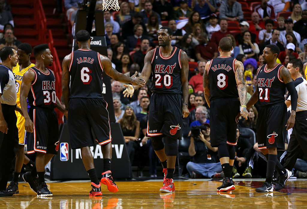 . Greg Oden #20 and LeBron James #6 of the Miami Heat high five during a game against the Los Angeles Lakers at American Airlines Arena on January 23, 2014 in Miami, Florida.  (Photo by Mike Ehrmann/Getty Images)