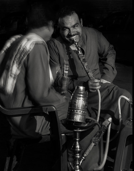 Men smoking shisha (water pipe) in Islamic Cairo.   Egypt, 2010.