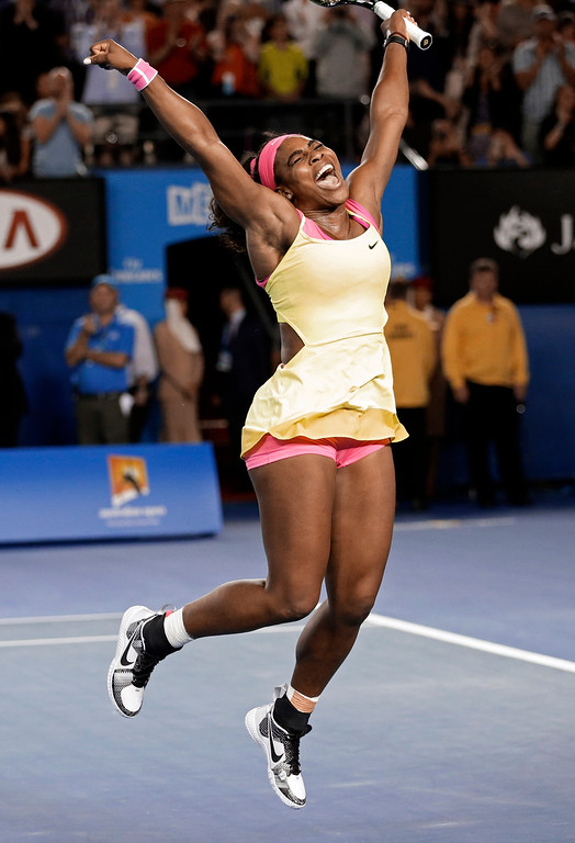 . Serena Williams of the U.S. celebrates after defeating Maria Sharapova of Russia in the women\'s singles final at the Australian Open tennis championship in Melbourne, Australia, Saturday, Jan. 31, 2015. (AP Photo/Bernat Armangue)