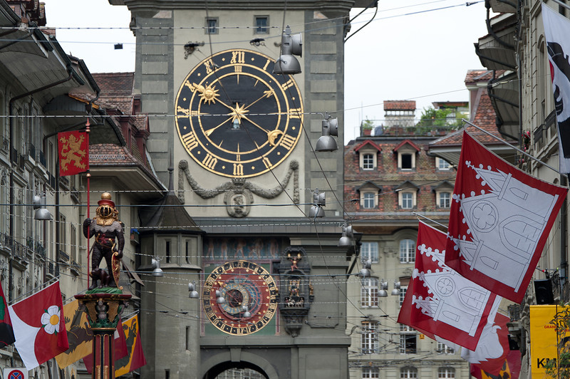 Banner Carrier Fountain with Zytglogge clock tower at the back - Bern, Switzerland