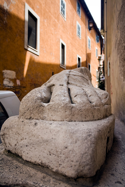 Gigantic foot of an ancient Roman statue on the street, Rome