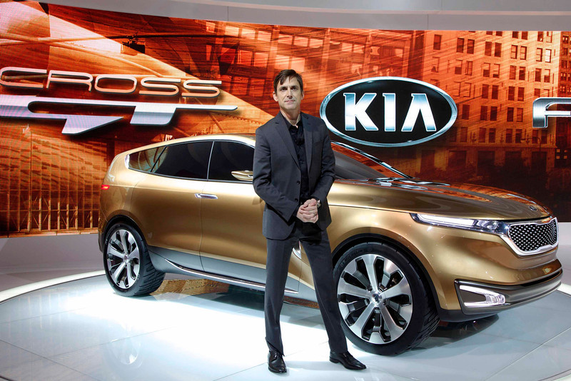 . Kia Design Center America\'s Tom Kearns poses with the Kia Cross GT at the Chicago Auto Show, February 7, 2013. REUTERS/John Gress