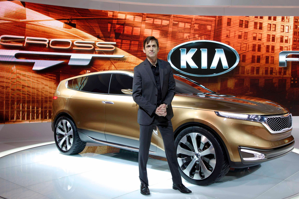 Description of . Kia Design Center America's Tom Kearns poses with the Kia Cross GT at the Chicago Auto Show, February 7, 2013. REUTERS/John Gress