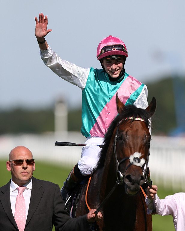 . James Doyle celebrates his victory riding Kingman in the St James\'s Palace Stakes on day one of Royal Ascot at Ascot Racecourse on June 17, 2014 in Ascot, England. (Photo by Steve Bardens/Getty Images)