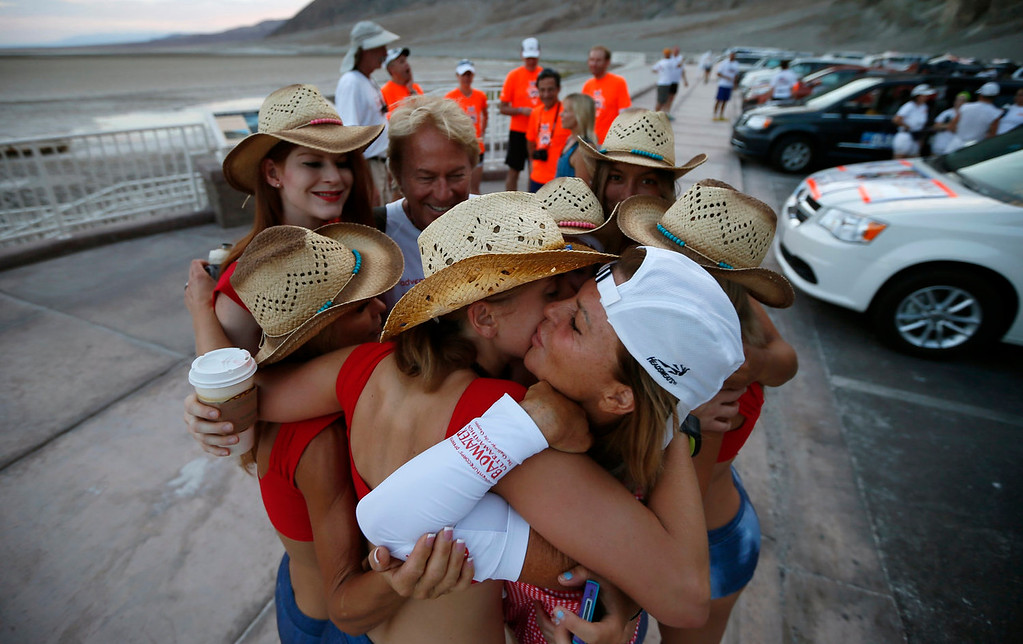 . Shannon Farar-Griefer, 52, of Hidden Hills, California, (2nd R) hugs her team before competing in the Badwater Ultramarathon in Death Valley National Park, California July 15, 2013. The 135-mile (217 km) race, which bills itself as the world\'s toughest foot race, goes from Death Valley to Mt. Whitney, California in temperatures which can reach 130 degrees Fahrenheit (55 Celsius). Farar-Griefer, who has multiple sclerosis, was hoping for her sixth finish in the race, but dropped out near mile 58. Picture taken July 15, 2013.   REUTERS/Lucy Nicholson