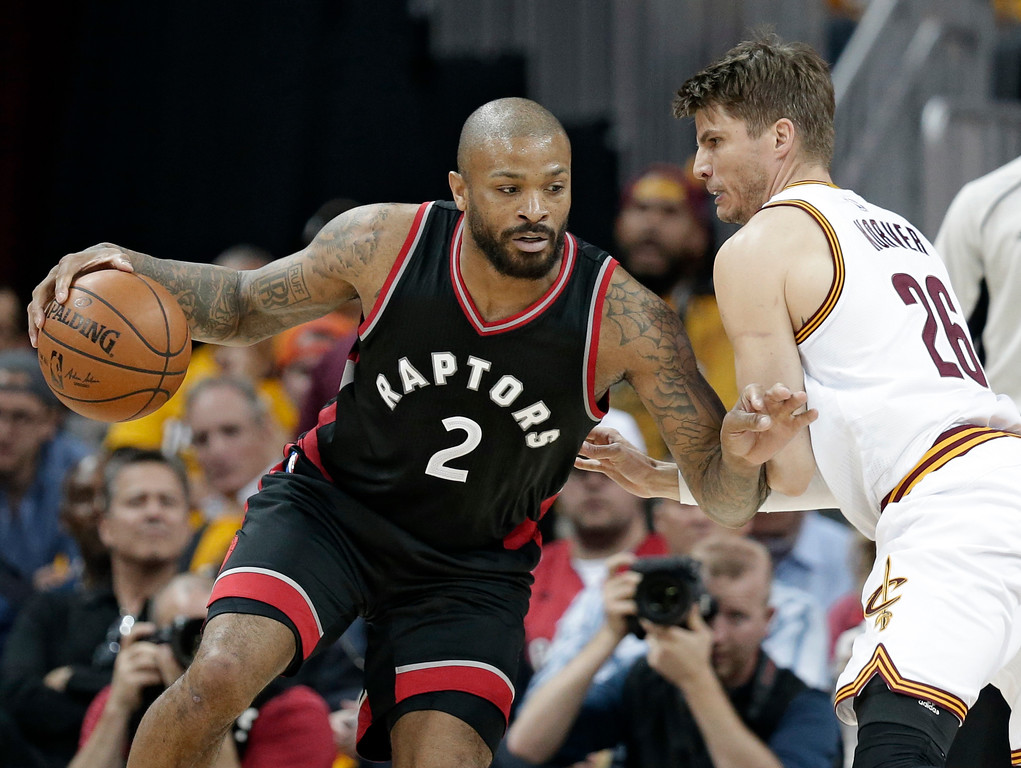 . Toronto Raptors\' P.J. Tucker (2) drives past Cleveland Cavaliers\' Kyle Korver (26) in the second half in Game 1 of a second-round NBA basketball playoff series, Monday, May 1, 2017, in Cleveland. The Cavaliers won 116-105. (AP Photo/Tony Dejak)