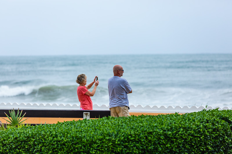 A couple watches the waves break on Palm Beach ahead of Hurricane Dorian side-swiping Florida's east coast on Labor Day, Monday, September 2, 2019. [JOSEPH FORZANO/palmbeachpost.com]