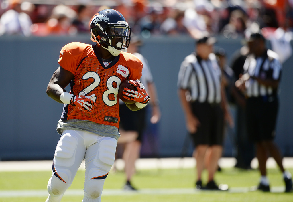 . Montee Ball of Denver Broncos (28) is warming up for the Broncos scrimmage at Sports Authority Field at Mile High. Denver, Colorado. August 02. 2014. (Photo by Hyoung Chang/The Denver Post)