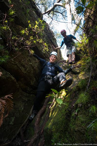 Jon climbing down into the canyon