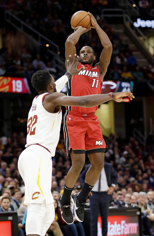 . Miami Heat\'s Dion Waiters (11) shoots over Cleveland Cavaliers\' Jeff Green (32) in the second half of an NBA basketball game, Tuesday, Nov. 28, 2017, in Cleveland. The Cavaliers won 108-97. (AP Photo/Tony Dejak)