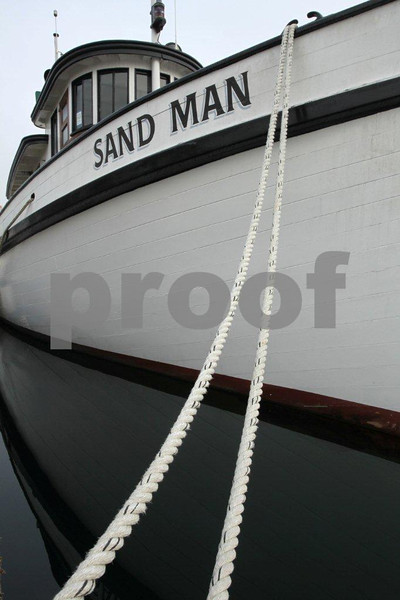 Sand Man 0969: A historic 60-foot long tug boat built in 1910 and moored in Olypmia, WA .