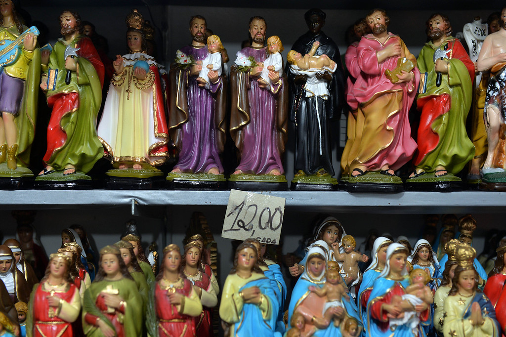 . Religious statuettes are displayed for sale in the downtown of Aparecida, Sao Paulo state, Brazil on July 23, 2013. Pope Francis\'s popularity on his Latin American home turf posed a challenge to Brazilian authorities Tuesday after adoring crowds mobbed his car on his landmark visit during the World Youth day (WYD) to Rio de Janeiro. On Wednesday, he will visit the Shrine of Our Lady of Aparecida in Sao Paulo state, where the explosive was discovered on Sunday. NELSON ALMEIDA/AFP/Getty Images