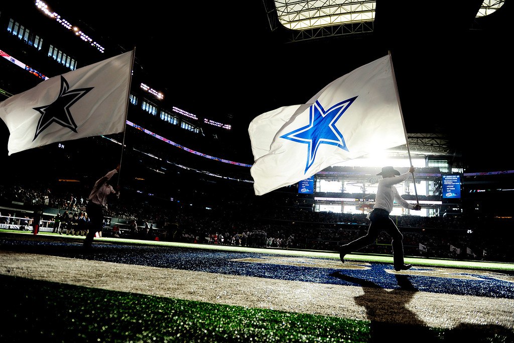 . The Dallas Cowboys flag crew waives the team banner after scoring a touchdown against the Denver Broncos during the second half of the Broncos\' 51-48 win at AT&T Stadium.   (Photo by AAron Ontiveroz/The Denver Post)