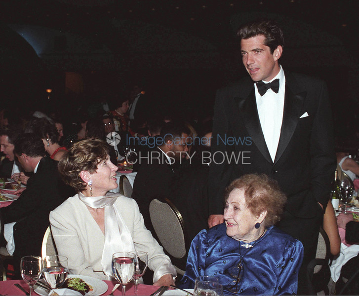 JFK Jr. stops by to say hello to reporter Sarah McClendon and Congresswoman Connie Morella at The White House Correspondents' Dinner.