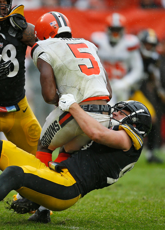 . Pittsburgh Steelers linebacker T.J. Watt (90) sacks Cleveland Browns quarterback Tyrod Taylor (5) during the second half of an NFL football game, Sunday, Sept. 9, 2018, in Cleveland. (AP Photo/Ron Schwane)