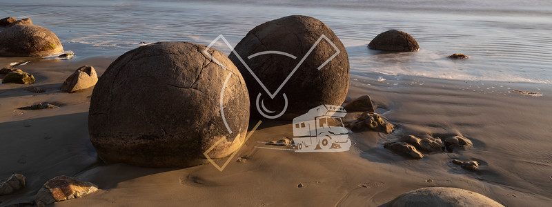 Moeraki Boulders on a sunny early morning New Zealand.
