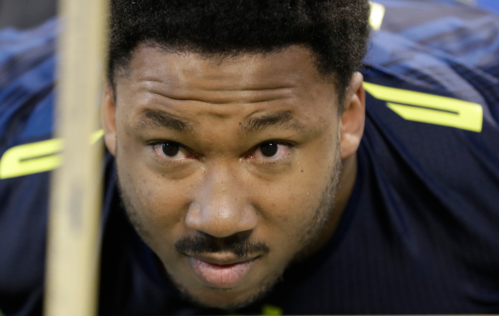 . Texas A&M defensive end Myles Garrett is tested for flexibility at the NFL football scouting combine Sunday, March 5, 2017, in Indianapolis. (AP Photo/David J. Phillip)