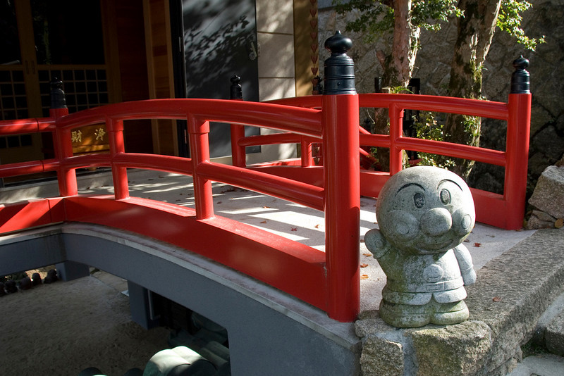 Modern Buddha statue at stairs in Daisho-in Temple - Miyajima, Japan