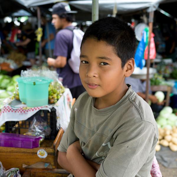 Portrait of boy in farmer's market, San Ignacio, Belize