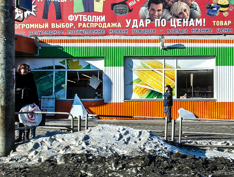 . People stand in front of the facade of a local shop which was damaged by a shockwave from a meteor in the Urals city of Chelyabinsk, on February 15, 2013. A meteor strike in central Russia that left today hundreds of people injured is the biggest known human toll from a space rock, a British expert said. OLEG KARGOPOLOV/AFP/Getty Images