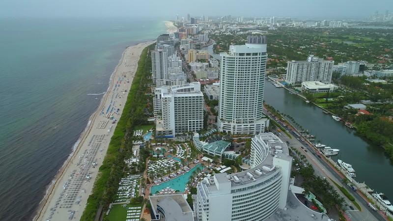 Aerial video hotels resorts and condominiums Miami Beach Collins Avenue