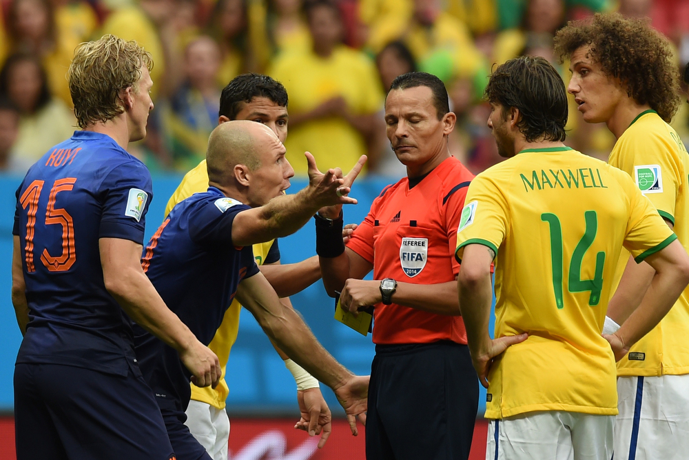 . Netherlands\' forward Arjen Robben (2nd-L) argues with Algerian referee Djamel Haimoudi (C) before Netherlands was awarded a penalty kick during the third place play-off football match between Brazil and Netherlands during the 2014 FIFA World Cup at the National Stadium in Brasilia on July 12, 2014. (VANDERLEI ALMEIDA/AFP/Getty Images)