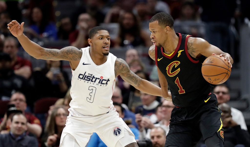 . Cleveland Cavaliers\' Rodney Hood (1) drives past Cleveland Cavaliers\' George Hill (3) in the second half of an NBA basketball game, Thursday, April 5, 2018, in Cleveland. (AP Photo/Tony Dejak)