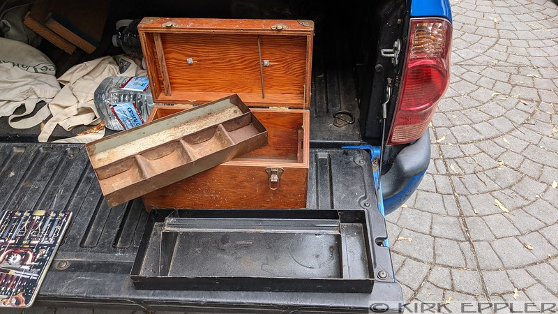 Small wooden case, possibly use made, with hand made tray.  non-magnetic corners protectors, extra tray for in house organization.