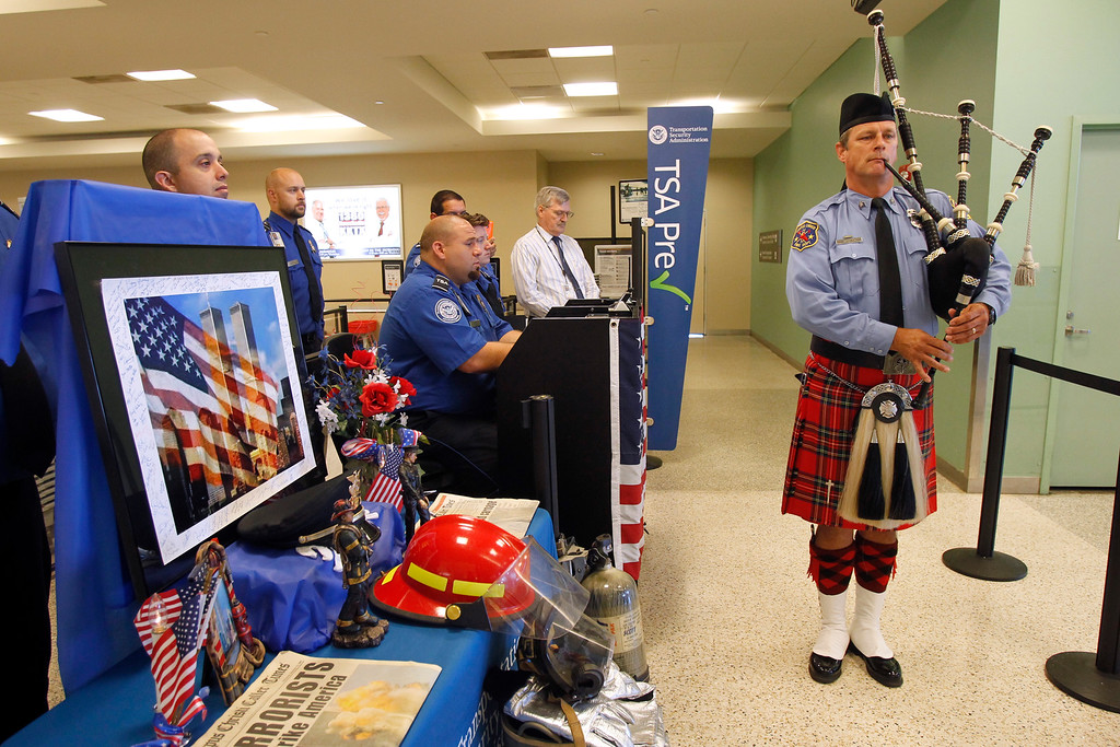 . Firefighter Dan Sheppard plays the bagpipes during a memorial service honoring the victims of the Sept. 11, 2001 terrorist attacks, Thursday, Sept. 11, 2014, at the Corpus Christi International Airport in Corpus Chriti Texas.  (AP Photo/Corpus Christi Caller-Times, Michael Zamora)