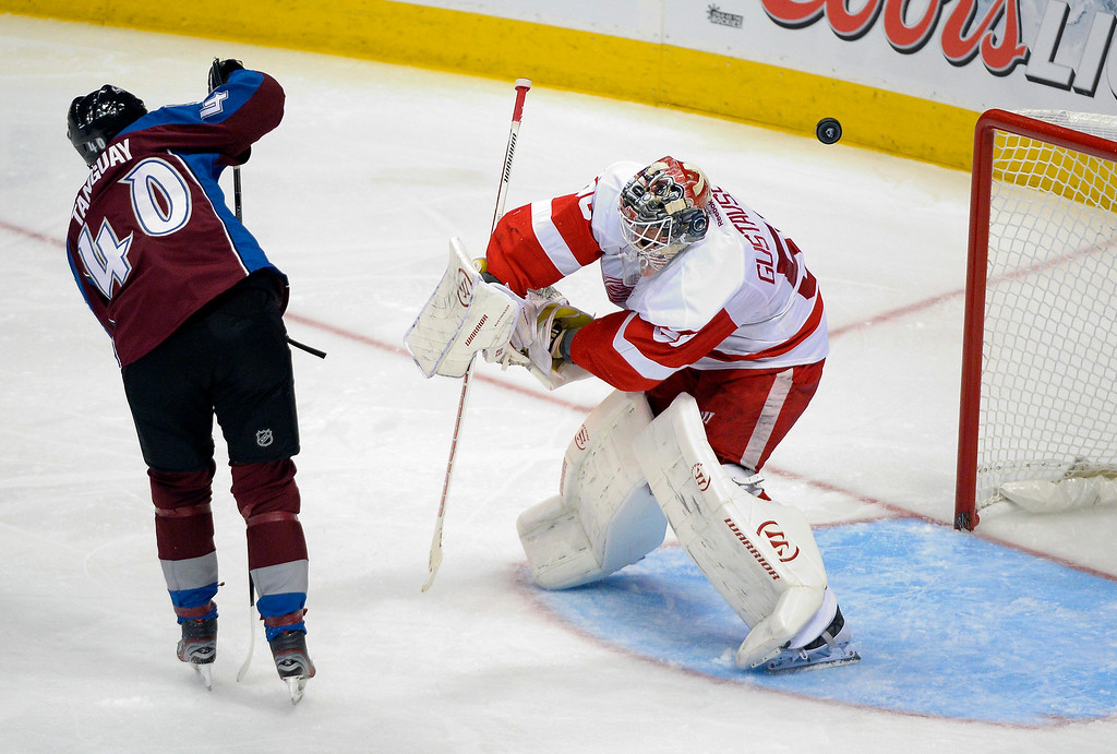 . Colorado Avalanche left wing Alex Tanguay (40) deflects a shot but sails over Detroit Red Wings goalie Jonas Gustavsson (50) and the goal during the second period October 17, 2013 at Pepsi Center.(Photo by John Leyba/The Denver Post)