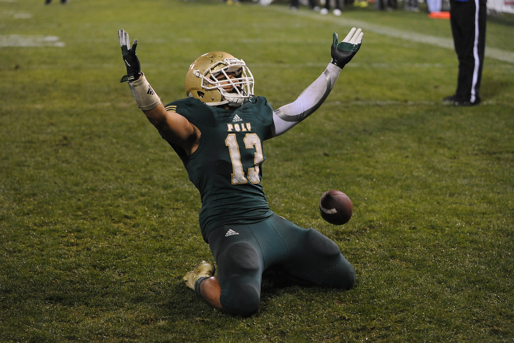 . Anaheim, Calif., --12-01-12 - Long Beach Poly\'s Manusamoa Luuga celebrates after scoring a touchdown in the fourth quarter. Long Beach defeated Mater Dei 35-17  for the CIF-SS Pac-5 Division championship, at Anaheim Stadium.   Stephen Carr/  LANG