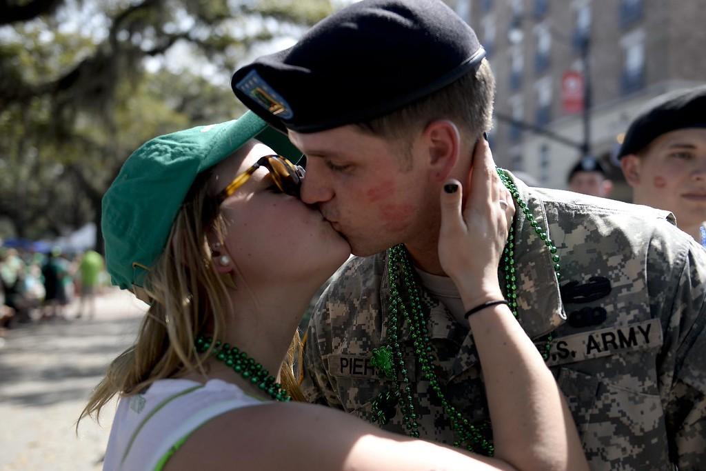 . Kristen Lynn, of Rockland, Ny., kisses a military member during the St. Patrick\'s Day Parade in Savannah, Ga., Tuesday, March 17, 2015. (AP Photo/Savannah Morning News, Ian Maule)