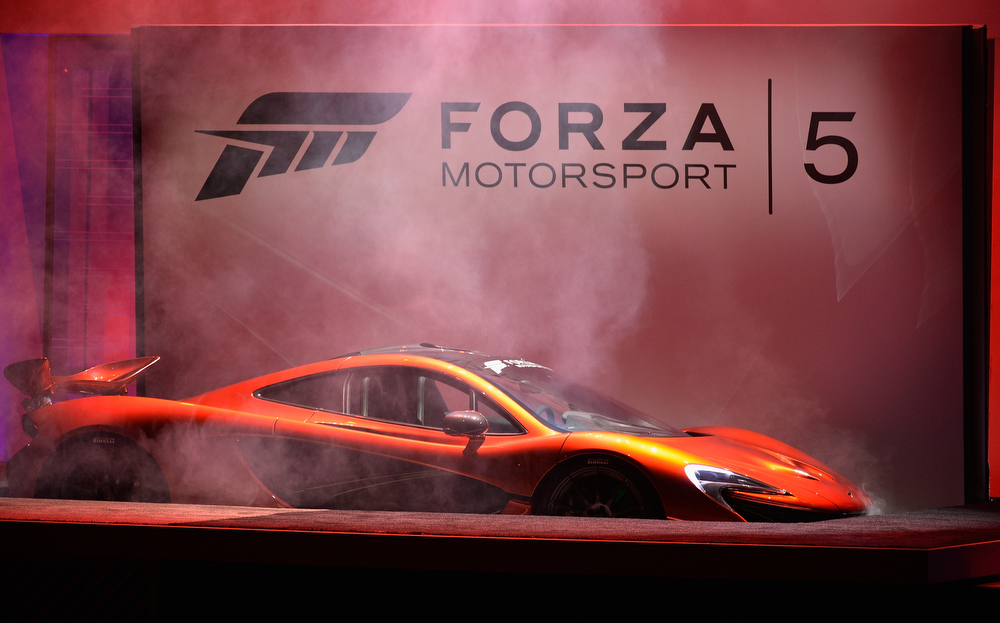 . A McLaren sports car is unveiled during the announcement of a new video game Forza Motorsport 5 during Microsoft Xbox news conference  at the Electronic Entertainment Expo at the Galen Center on June 10, 2013 in Los Angeles, California. Thousands are expected to attend the annual three-day convention to see the latest games and announcements from the gaming industry.  (Photo by Kevork Djansezian/Getty Images)