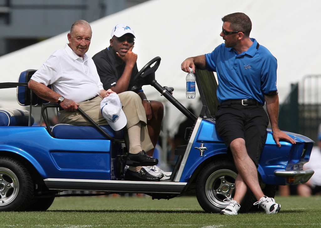 . Detroit Lions owner William Clay Ford, left, sits with team general manager Martin Mayhew, center, and talks with president Tom Lewand, right,during  NFL football training camp in Allen Park, Mich., Friday, Aug. 7, 2009. (AP Photo/Carlos Osorio)