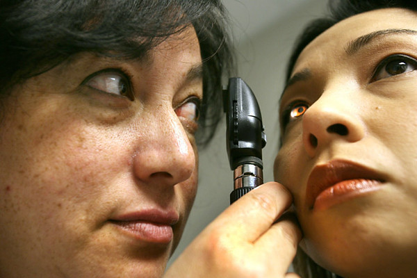 Laura Schwartz is a nurse practitioner, running an employee health and wellness clinic at the Pepsi Bottling plant in Hayward.  Here she puts Lisa Cruz, Human Resources coordinator at the plant, through some tests. Silicon Valley-San Jose Business Journal/Dino Vournas