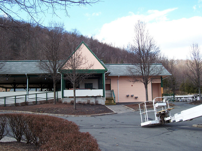 The newly-painted, peach colored Saw Mill Plunge building.