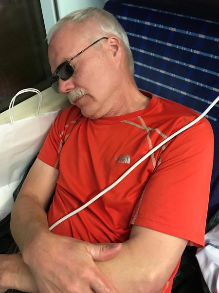 Sheldon sleeping on the train