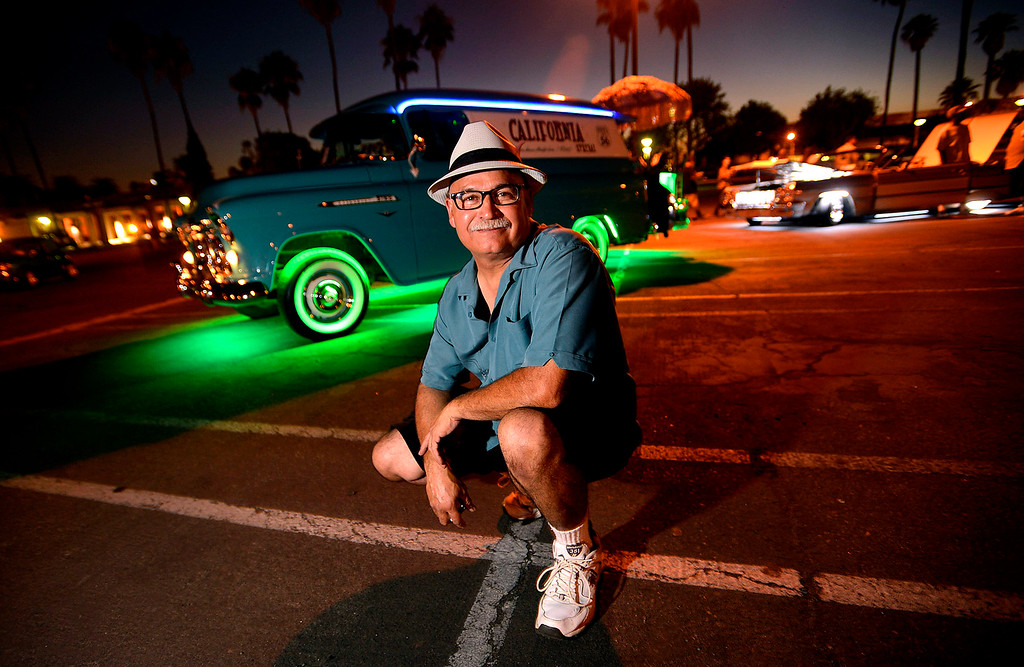 . Pete Rodriquez, 56, of Hesperia, poses with his 1956 Chevrolet Panel truck prior to competing in the Neon Light Contest during Day 2 of the 23rd Annual Stater Brothers Route 66 Rendezvous in downtown San Bernardino September 14, 2012.  Rodriguez was competing for the 11th straight year in the annual competition.  (Photo by Gabriel Luis Acosta/The Sun)