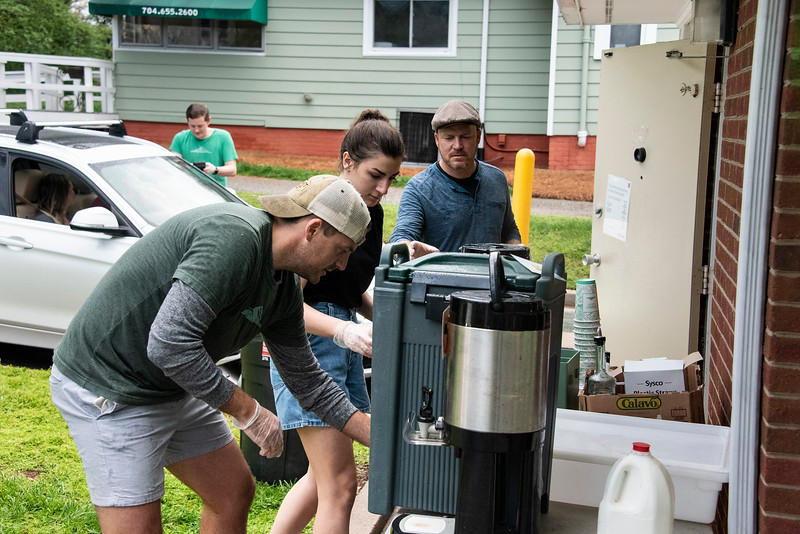 Six Summit employees were on hand this morning to handle the rush of customers who showed up to enjoy some Summit coffee and Kindred milk bread doughnuts. (Bill Giduz photo)