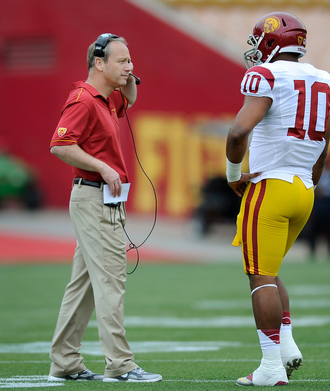 . Defensive coordinator Clancy Pendergast talks with LB Hayes Pullard during USC\'s Spring Football Game at the L.A. Memorial Coliseum, Saturday, April 13, 2013. (Michael Owen Baker/Staff Photographer)
