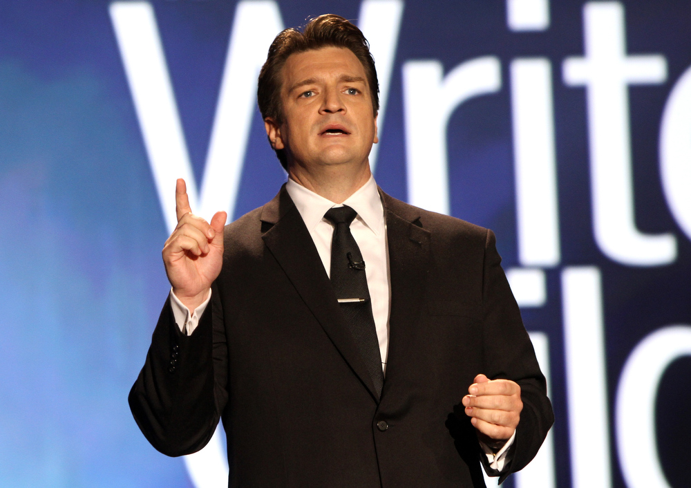 Description of . Host Nathan Fillion speaks onstage at the 2013 WGAw Writers Guild Awards at JW Marriott Los Angeles at L.A. LIVE on February 17, 2013 in Los Angeles, California.  (Photo by Maury Phillips/Getty Images for WGAw)