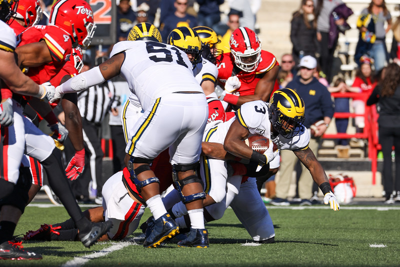Michigan RB Christian Turner carries the ball through a gap in the line.
