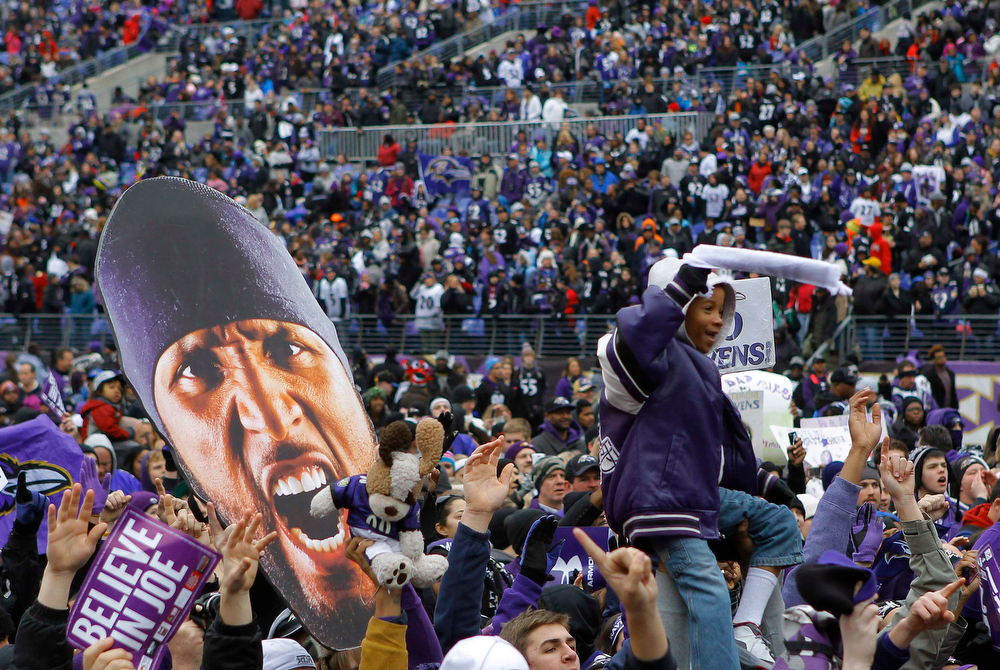 . Fans of Super Bowl XLVII champion Baltimore Ravens celebrate their victory before a stadium rally in Baltimore February 5, 2013. The Ravens defeated the San Francisco 49ers to win the NFL championship. The player cut-out (L) is of retiring Ravens\' linebacker Ray Lewis.    REUTERS/Gary Cameron