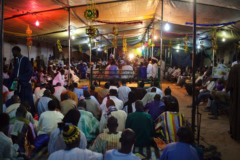 . People from the Mouride sect of Sufi Islam attend a prayer session in the village of Ndande, May 18, 2013. Every year, inhabitants of the village take part in a Sufi Muslim ceremony called Gamou-Ndande. The ceremony combines nights of praying and chanting as well as traditionally animist ceremonies. Picture taken May 18, 2013. REUTERS/Joe Penney
